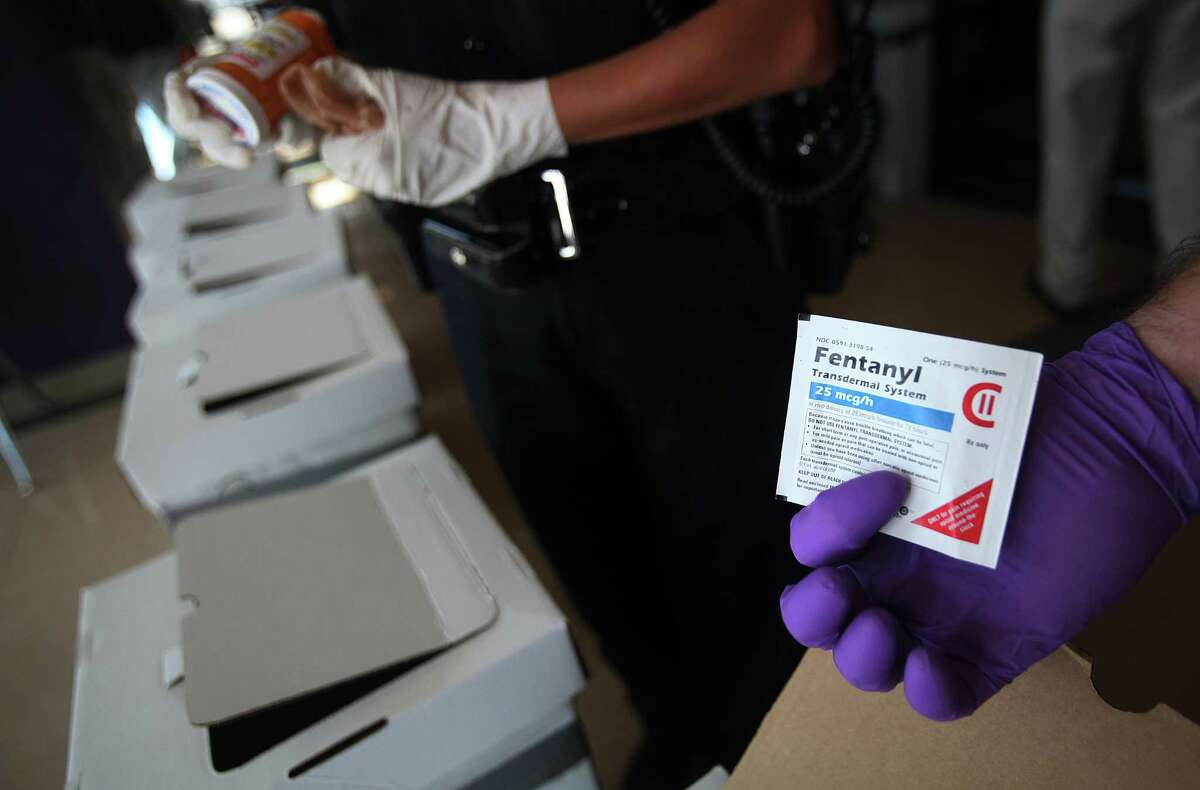 A DEA agent is glad citizens are turning in controlled substances such as Fentanyl at the Houston Community College Drug Take-Back site on September 25, 2010 in Houston, TX. This is a national event sponsored by the DEA that encourages members of the public to turn in unwanted, expired and potentially dangerous prescription medicines with no questions asked. All of the items collected will be weighed and then incinerated. The process of turning in drugs in guaranteed to be anonymous.