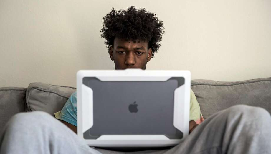 Warriors rookie James Wiseman plays some beats he created on his laptop in his apartment in San Francisco on March 28, 2021. Photographer's note: To adhere to the NBA's coronavirus precautions, this photo was made from a remote camera held by Wiseman's assistant inside the apartment while the photographer, looking at a computer outside, triggered the frame. Photo: Carlos Avila Gonzalez / The Chronicle