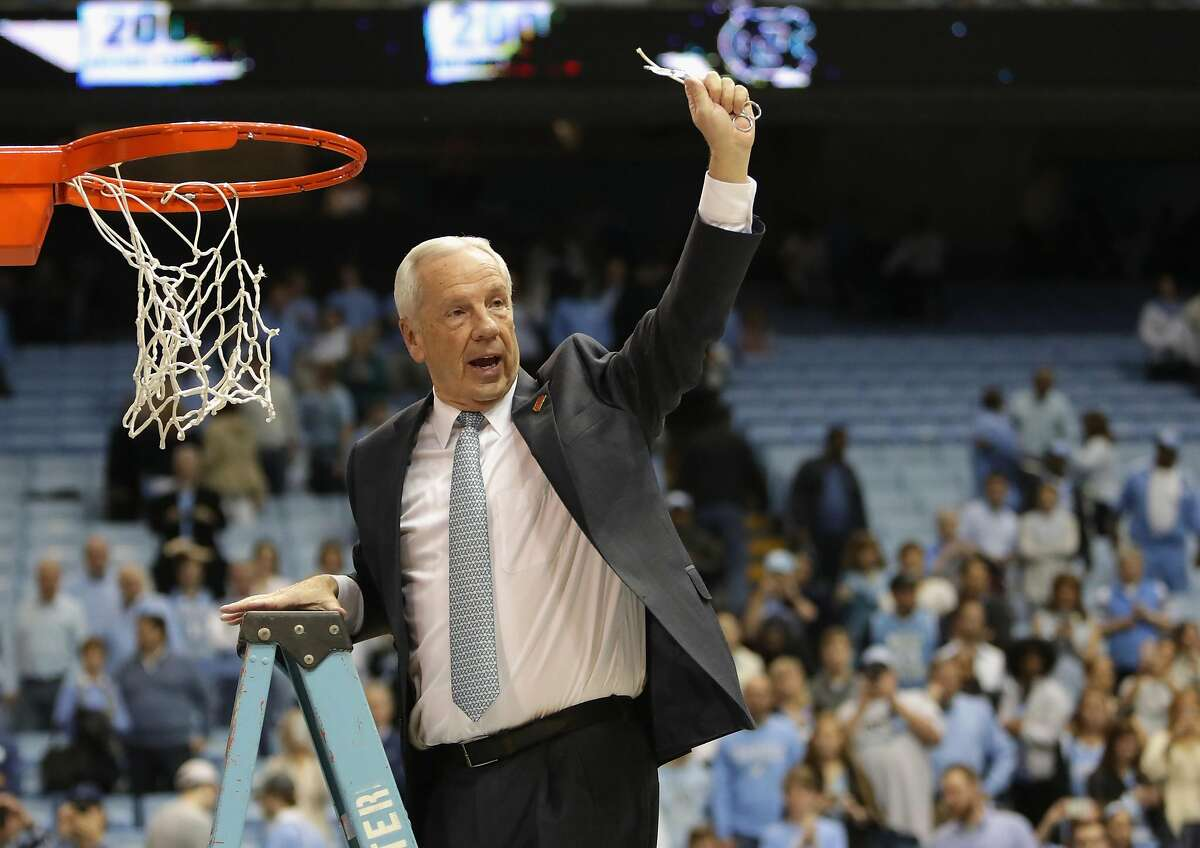 Head coach Roy Williams of the North Carolina Tar Heels celebrates as he cuts down the net after defeating the Duke Blue Devils 90-83 to clinch the ACC regular season title at the Dean Smith Center on March 4, 2017 in Chapel Hill, North Carolina. (Streeter Lecka/Getty Images/TNS)