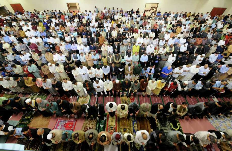 Muslims attend Eid services Friday in the new Muslim Community Center at the Islamic Center of the Capital District in Colonie. The Eid celebration marks the end of Ramadan, the Muslim holy month. (Skip Dickstein / Times Union) Photo: Skip Dickstein