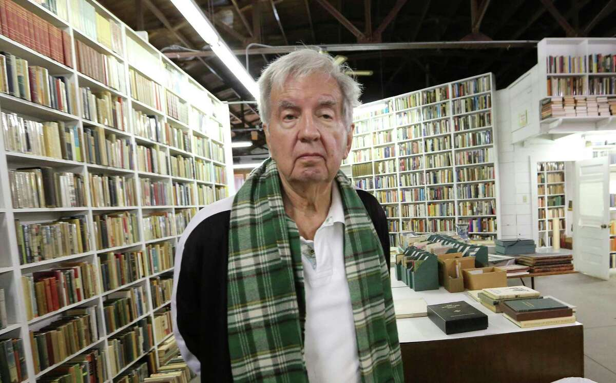 """FILE - In this April 30, 2014, file photo, Pulitzer Prize-winning author Larry McMurtry poses at his book store in Archer City, Texas. McMurtry has died at the age of 84. His death was confirmed Friday, March 26, 2021, by a spokesman for his publisher Liveright. Several of McMurtry's books became feature films, including the Oscar-winning films """"The Last Picture Show"""" and """"Terms of Endearment."""" He also co-wrote the Oscar-winning screenplay for """"Brokeback Mountain."""" (AP Photo/LM Otero, File)"""