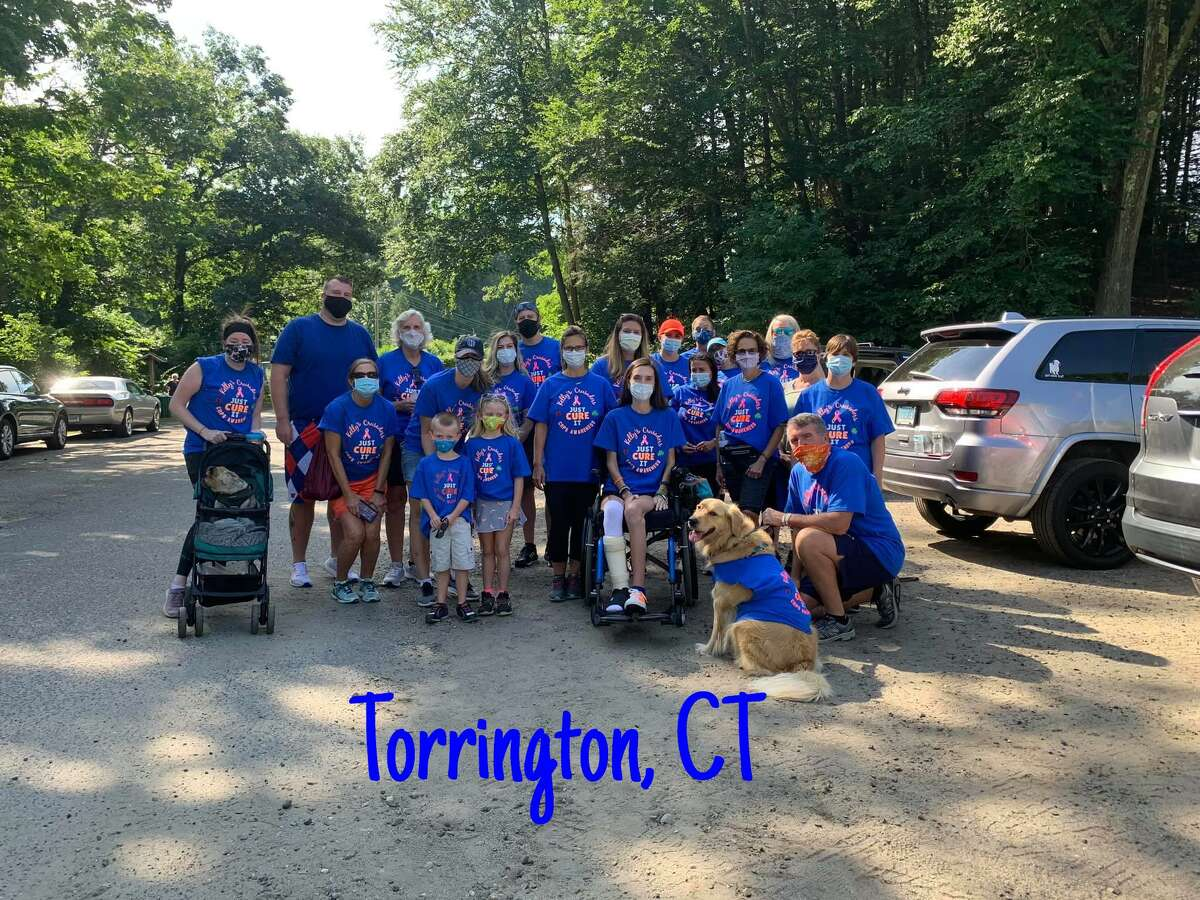 Kelly Considine of Torrington, seated, with members of her team, Kelly's Crusaders, held a fundraising walk for CRPS on the Sue Grossman Still River Greenway in Torrington in 2020.