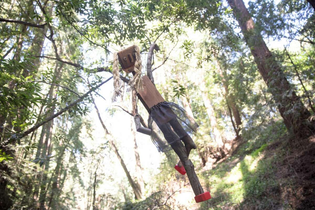 Quincy, one of the trolls along the Bridgeview Trail, hangs from a line on March 31, 2021, in Oakland, Calif.