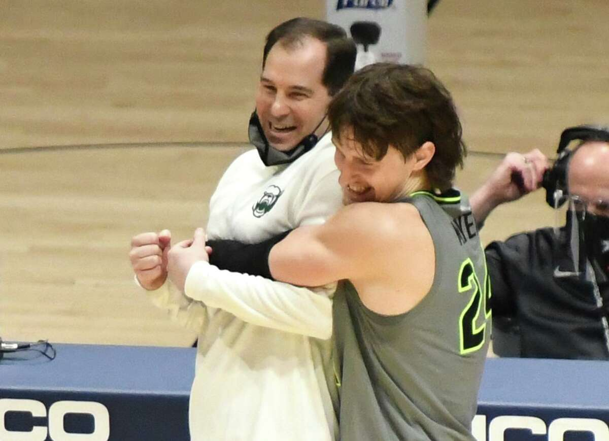 Baylor coach Scott Drew, left, and forward Matthew Mayer celebrate an overtime win at West Virginia this season.