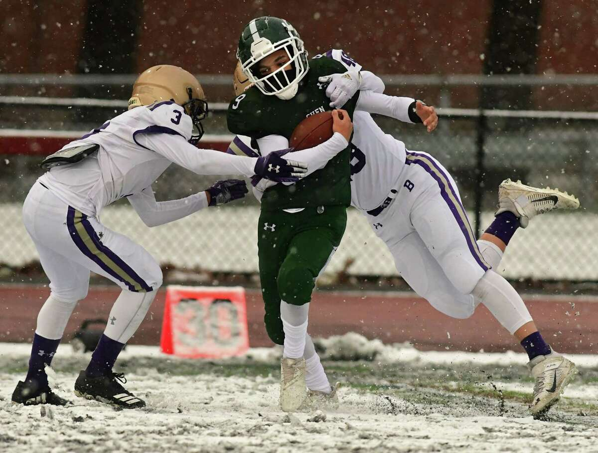 Shenendehowa's Trevon Joyner carries the ball defended by Christian Brothers Academy's Jesse Goebel, left, and Chuck Volans during a football game on Thursday, April 1, 2021 in Clifton Park, N.Y. (Lori Van Buren/Times Union)