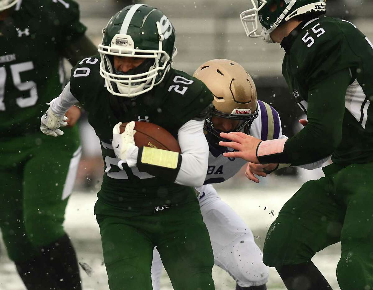 Shenendehowa's Dyvante Terrelonge escapes a tackle and makes a touchdown during a football game against Christian Brothers Academy on Thursday, April 1, 2021 in Clifton Park, N.Y. (Lori Van Buren/Times Union)