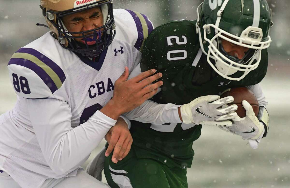 Christian Brothers Academy's David Clement, #88, tackles Shenendehowa's Dyvante Terrelonge during a football game on Thursday, April 1, 2021 in Clifton Park, N.Y. (Lori Van Buren/Times Union)
