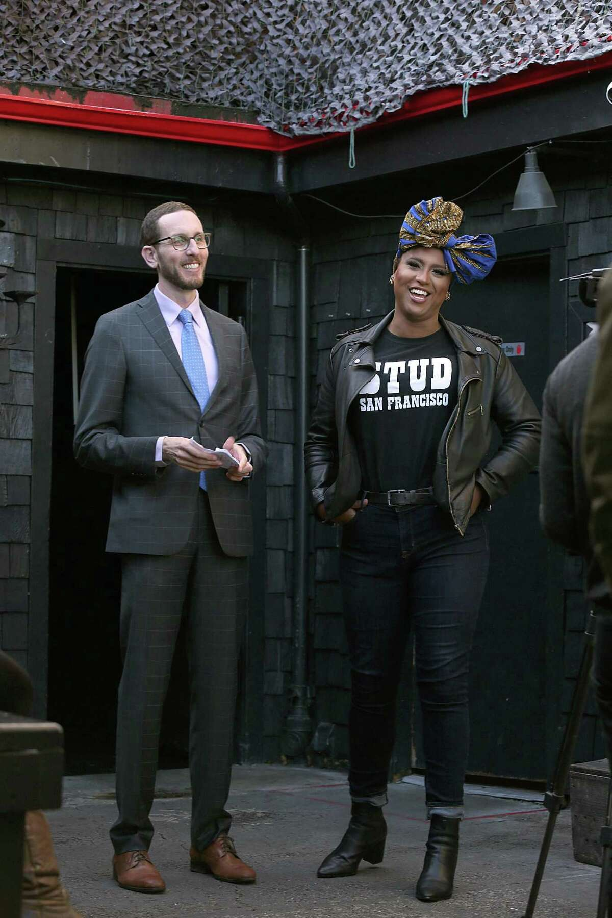 State Sen. Scott Wiener (left) talks with Honey Mahogany in 2017 after announcing a bill that would allow bars to stay open until 4 a.m. is being reintroduced at San Francisco Eagle bar.