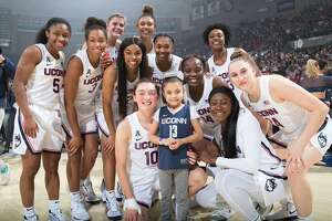 Daniela Ciriello is pictured with the 2019-20 UConn women's basketball team. Ciriello, who suffers from a genetic blood disorder, was named a member of the team two years ago and keeps in close contact with the team. This week she was surprised with a trip to the Final Four.