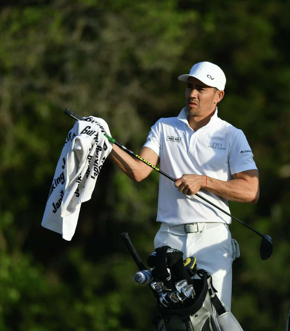 ?Camilo Villegas wipes off his club on the eighth during the Valero Texas Open on Thursday, April 1, ?2021.