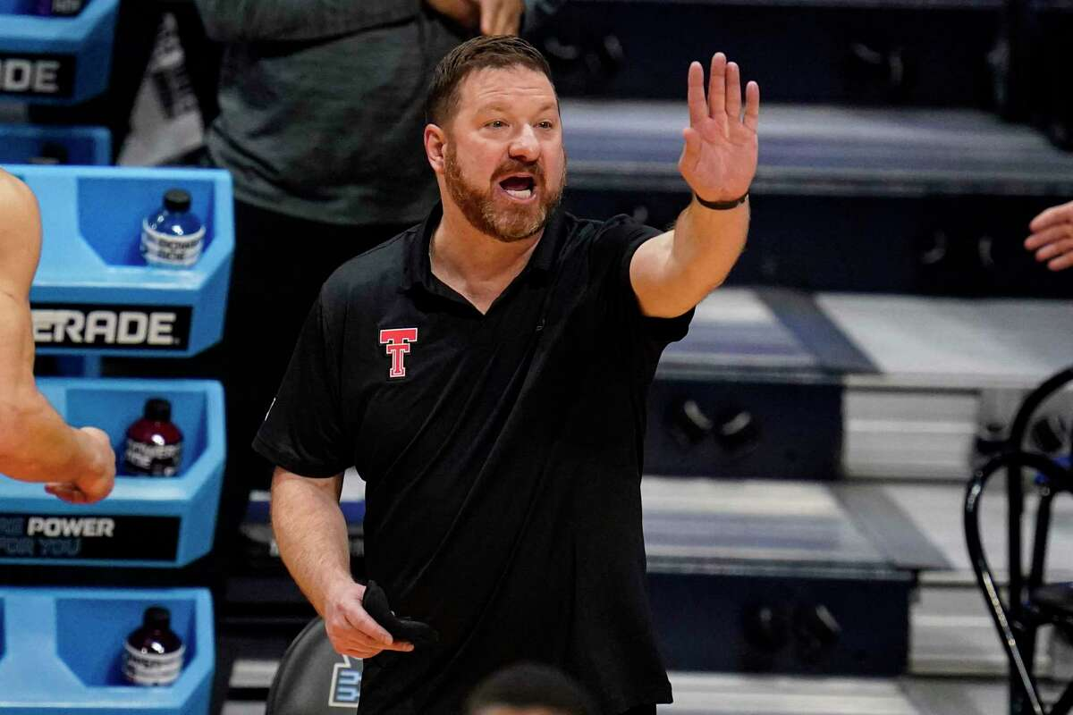 Texas Tech head coach Chris Beard signals to his team as they played against Arkansas in the first half of a second-round game in the NCAA men's college basketball tournament at Hinkle Fieldhouse in Indianapolis, Sunday, March 21, 2021. (AP Photo/Michael Conroy)