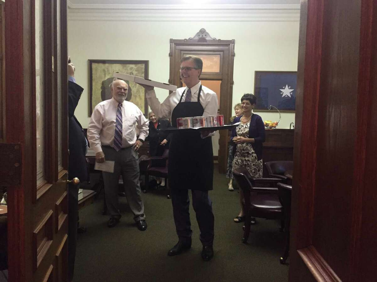 Lt. Gov. Dan Patrick delivers pizza and sodas to state senators just before he convenes the Senate in the first minutes of Thursday, July 20, 2017. The Senate has suspended rules as it rushes forward to pass sunset legislation that would continue the Texas Board of Medical Examiners and other agencies.