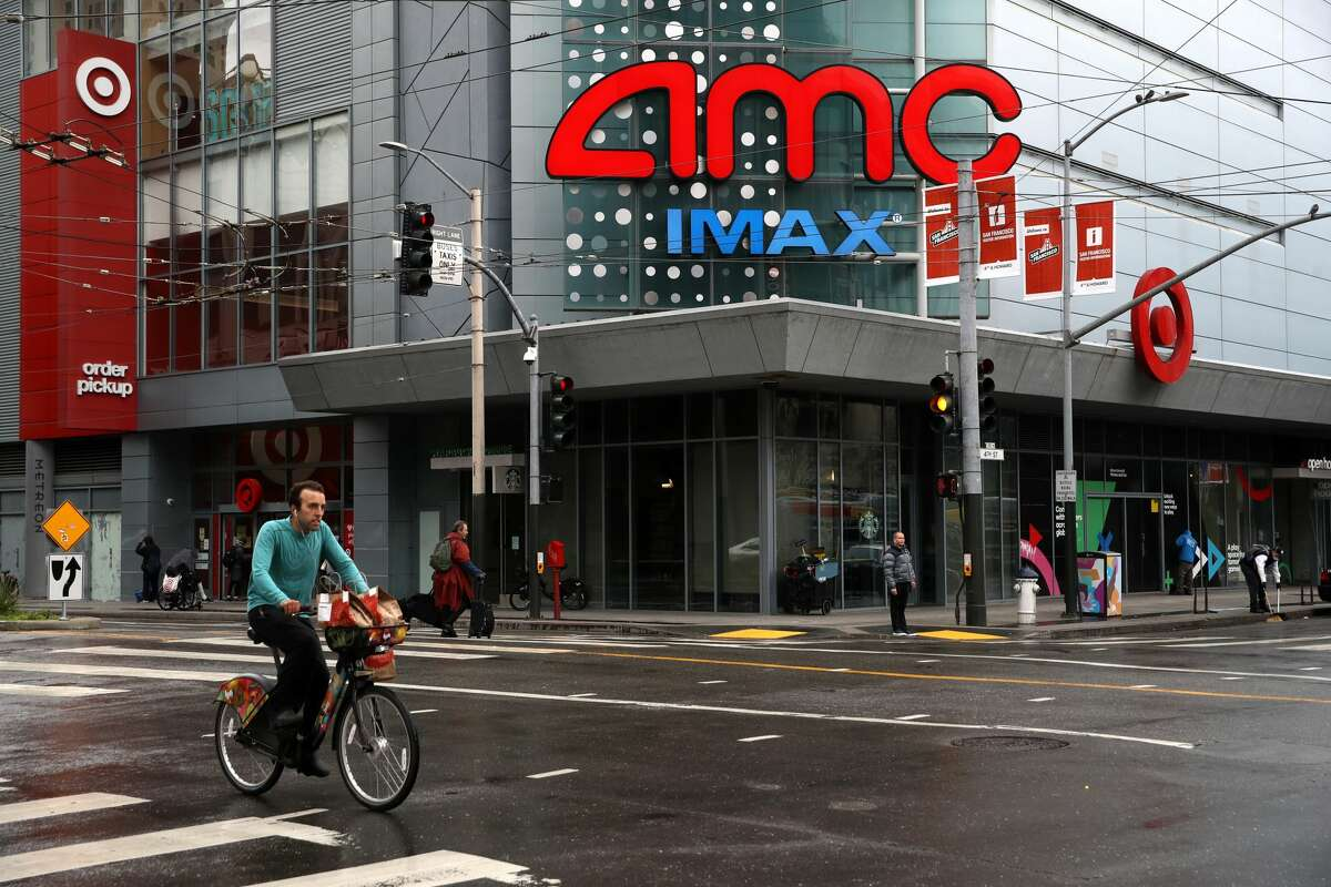 A cyclist rides his bike by an AMC theatre during the coronavirus (COVID-19) pandemic on April 06, 2020 in San Francisco, California.