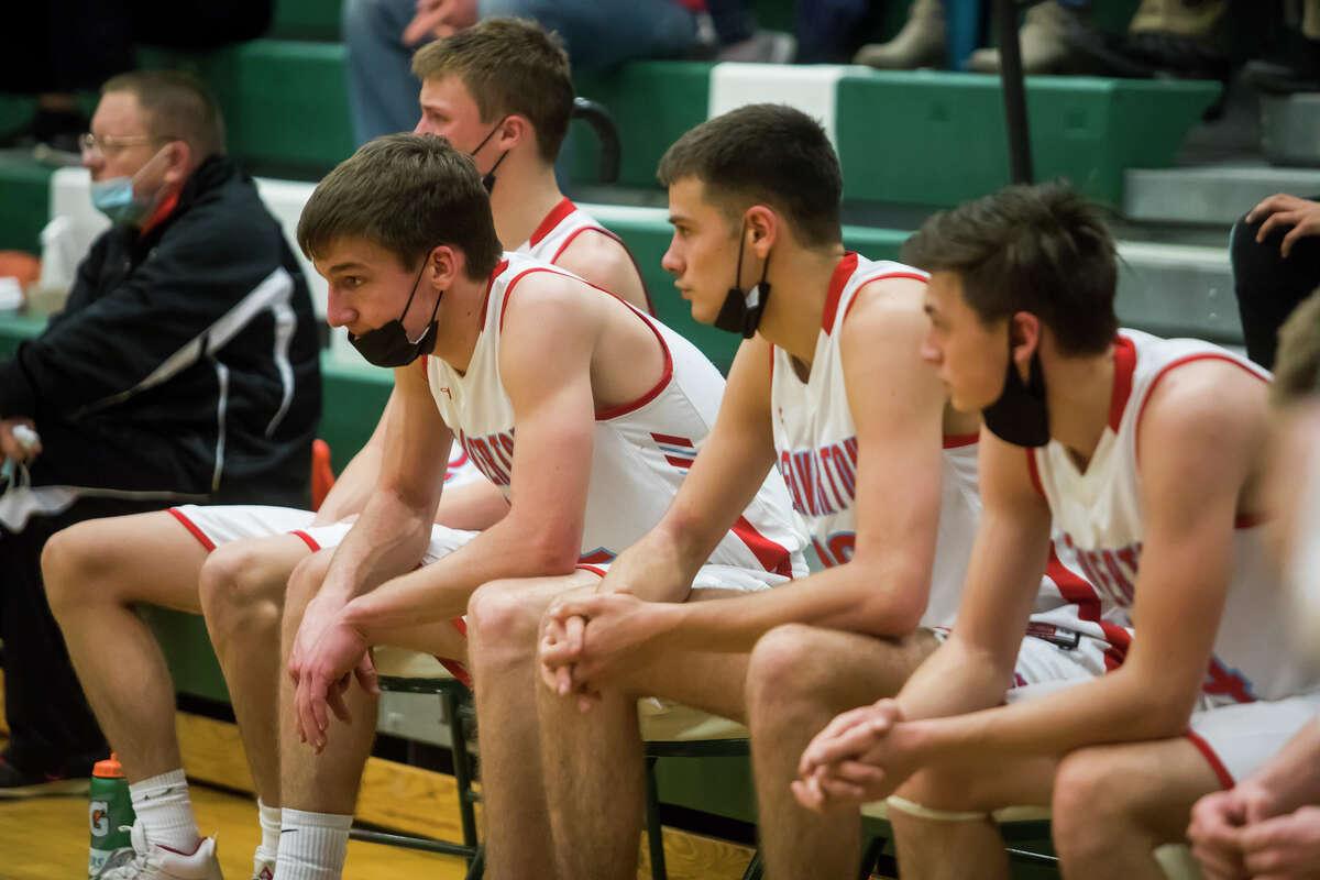 Beaverton's Trent Reed, left, takes a seat alongside his teammates after their regional championship loss to McBain Thursday, April 1, 2021 at Houghton Lake High School. (Katy Kildee/kkildee@mdn.net)