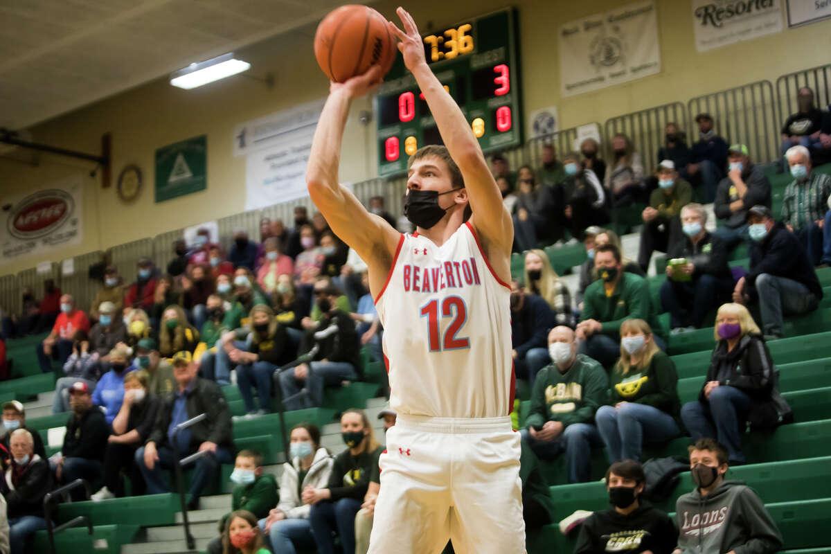 Beaverton's Trent Reed takes a shot during the Beavers' regional championship loss to McBain Thursday, April 1, 2021 at Houghton Lake High School. (Katy Kildee/kkildee@mdn.net)