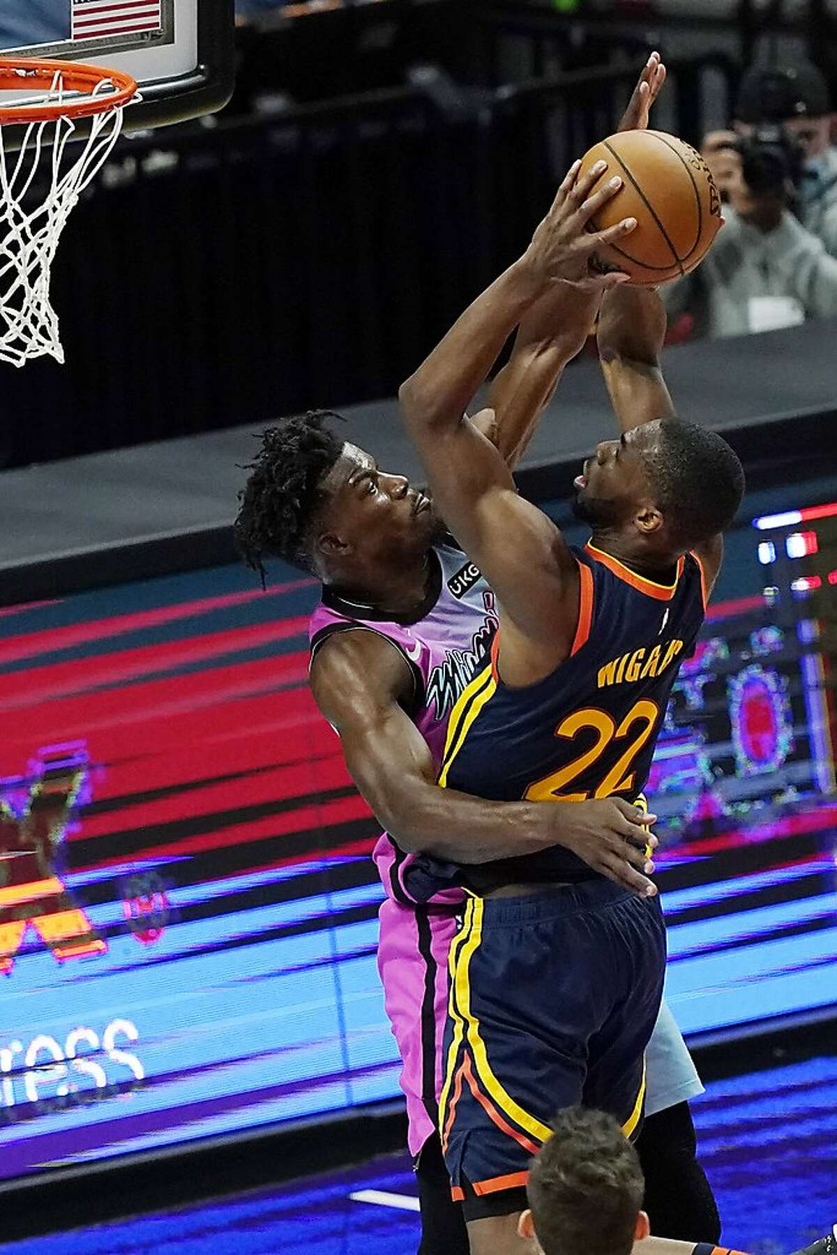 Golden State Warriors forward Andrew Wiggins drives to the basket as Miami Heat forward Jimmy Butler defends during the second half Thursday.