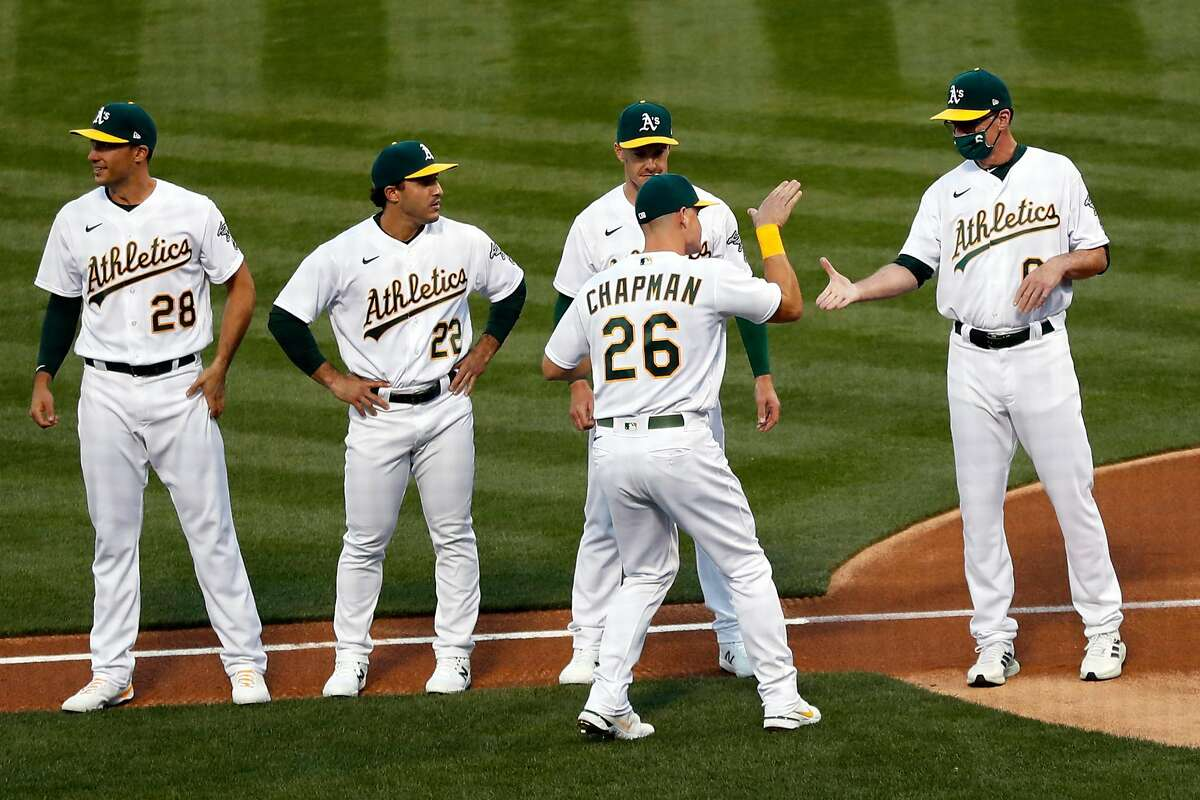 A's third baseman Matt Chapman greets manager Bob Melvin during player introductions before the game Thursday.