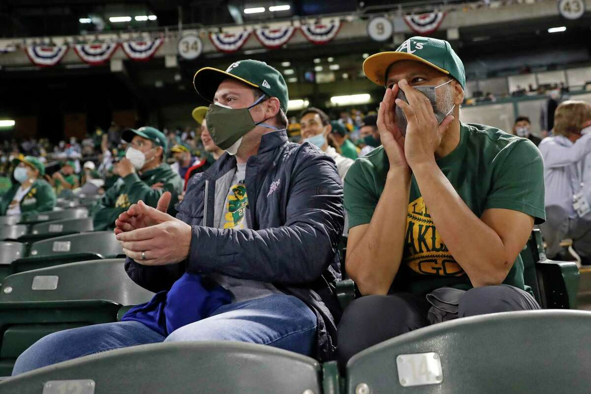 While Nathaniel Zuckerman, left, was encouraging the hometown A's, Kais Shirgul took verbal aim at Astros shortstop Carlos Correa during Thursday night's season opener at the Oakland Coliseum.