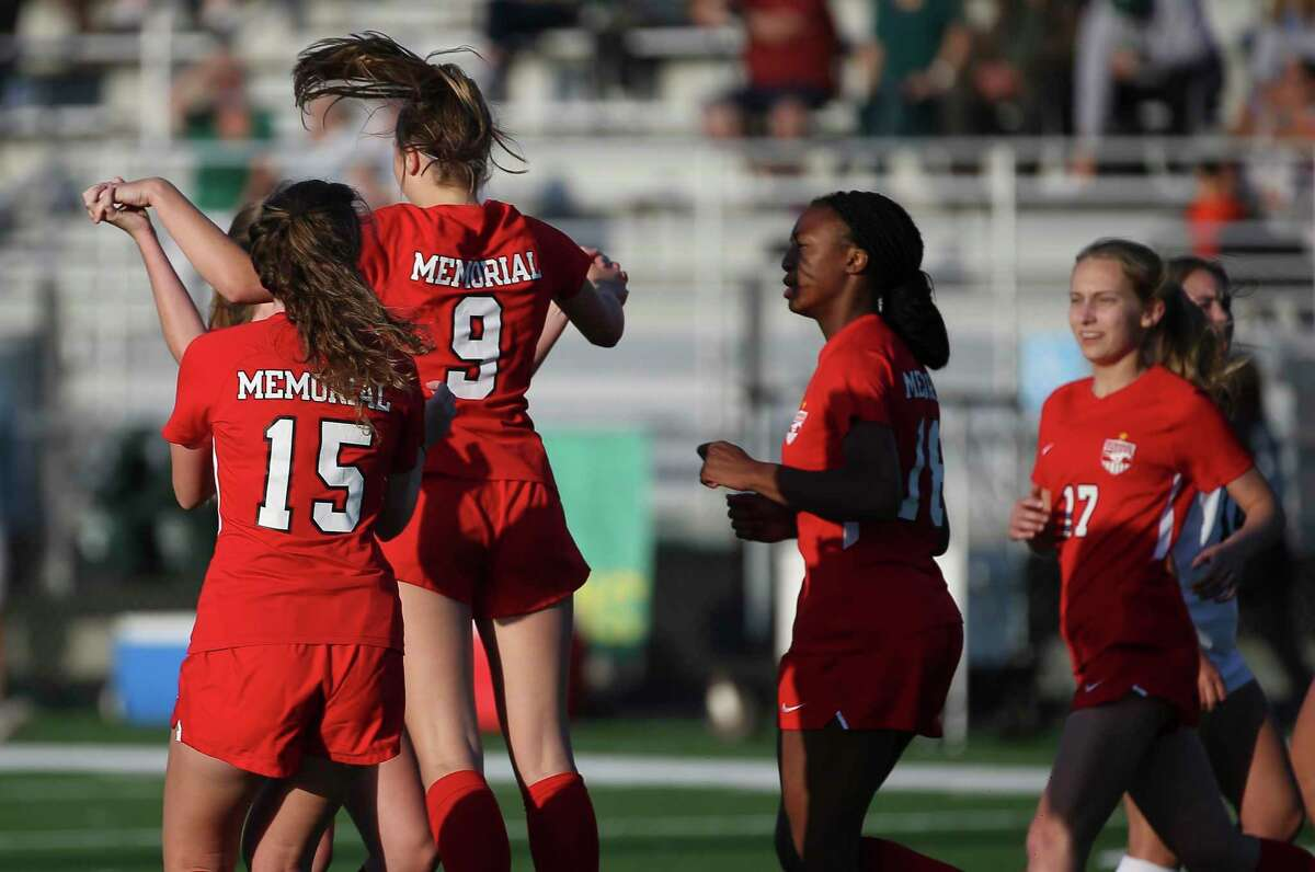 Memorial Mustangs midfielder Abigail Mohun (9) celebrates scoring with a penalty kick during the first half of the conference 6A regional quarterfinal match against Stratford Spartans Thursday, April 1, 2021, at Spring Woods High School in Houston.