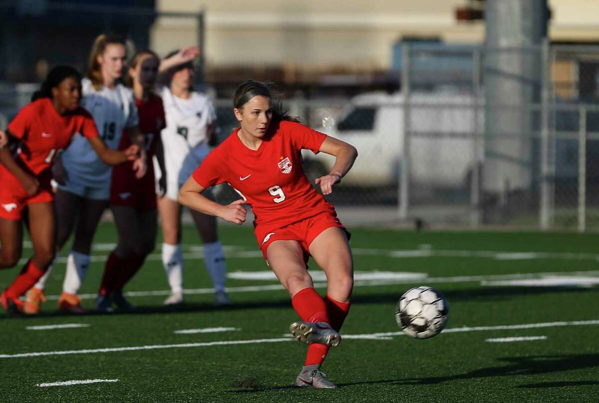Memorial Mustangs midfielder Abigail Mohun (9) scores with a penalty kick during the first half of the conference 6A regional quarterfinal match against Stratford Spartans Thursday, April 1, 2021, at Spring Woods High School in Houston.