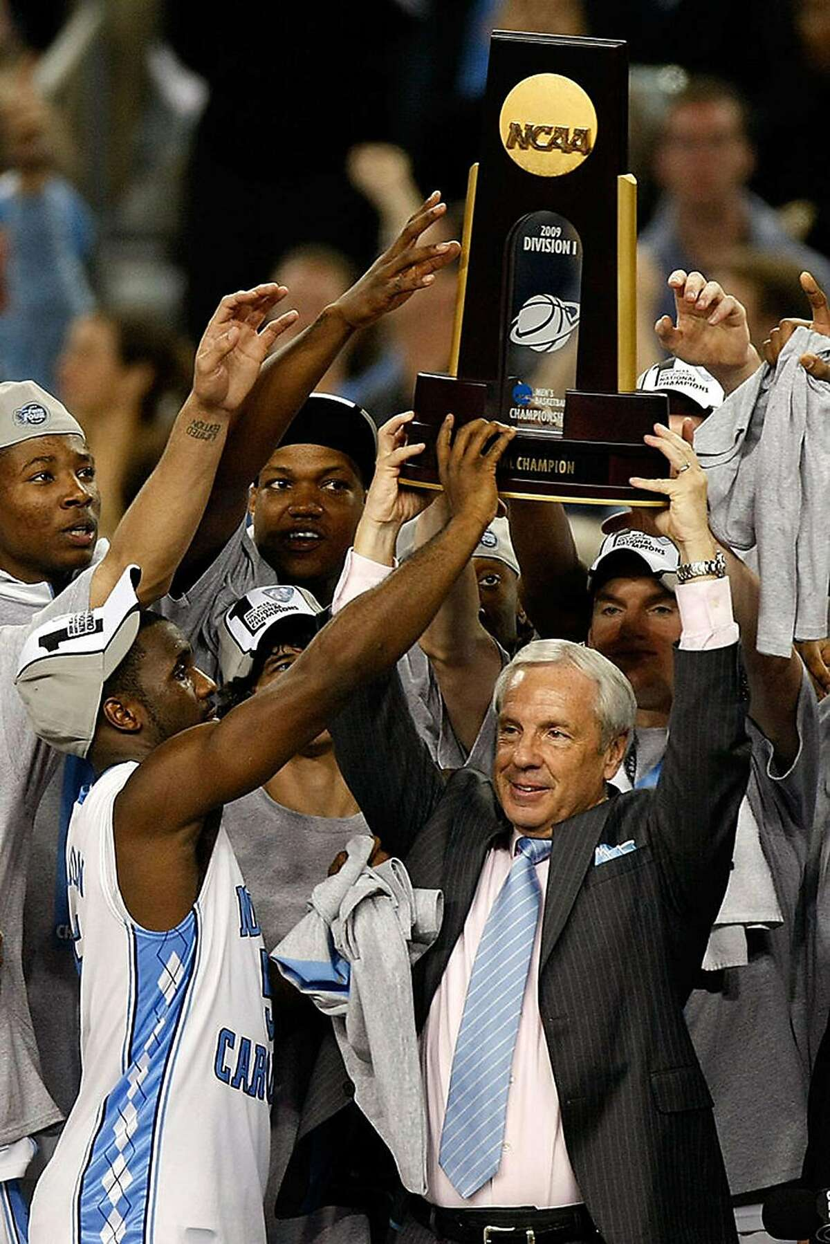 Head coach Roy Williams of the North Carolina Tar Heels celebrates with the championship trophy after defeating the Michigan State Spartans 89-72 during the 2009 NCAA Division I Men's Basketball National Championship game at Ford Field on April 6, 2009 in Detroit, Michigan. (Photo by Gregory Shamus/Getty Images/TNS)