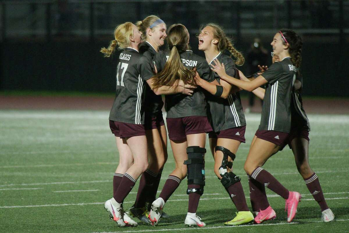 Clear Creek celebrates a goal by Clear Creek's Reaghan Thompson (14) against Brazoswood Thursday, Apr. 1 at Pearland High School.
