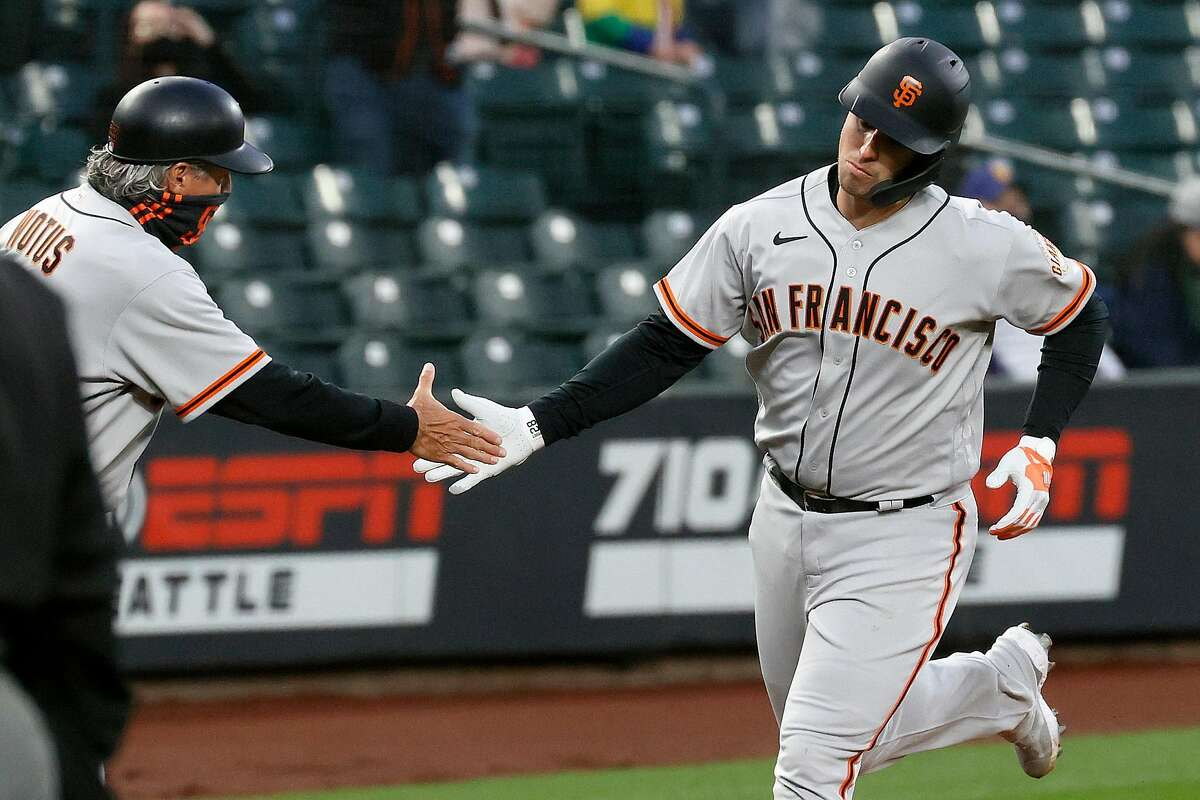 SEATTLE, WASHINGTON - APRIL 01: Buster Posey #28 of the San Francisco Giants reacts after his home run against the Seattle Mariners in the second inning on Opening Day at T-Mobile Park on April 01, 2021 in Seattle, Washington. (Photo by Steph Chambers/Getty Images)