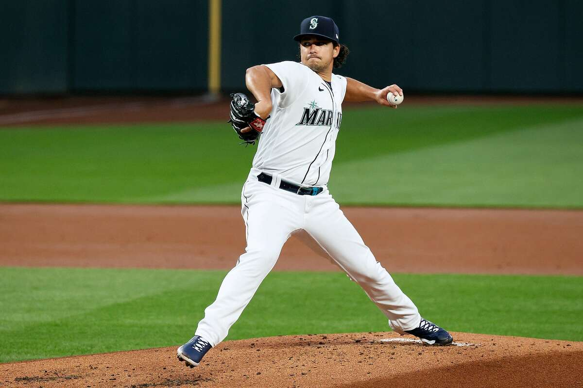 SEATTLE, WASHINGTON - APRIL 01: Marco Gonzales #7 of the Seattle Mariners pitches in the first inning against the San Francisco Giants on Opening Day at T-Mobile Park on April 01, 2021 in Seattle, Washington. (Photo by Steph Chambers/Getty Images)