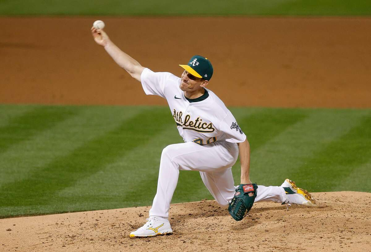 OAKLAND, CALIFORNIA - APRIL 01: Chris Bassitt #40 of the Oakland Athletics pitches against the Houston Astros in the fifth inning of their Opening Day game at RingCentral Coliseum on April 01, 2021 in Oakland, California. (Photo by Ezra Shaw/Getty Images)