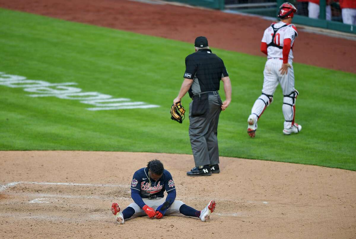 Ozzie Albies reacts after being tagged out at home in the 10th inning of the Braves' loss to the Phillies.