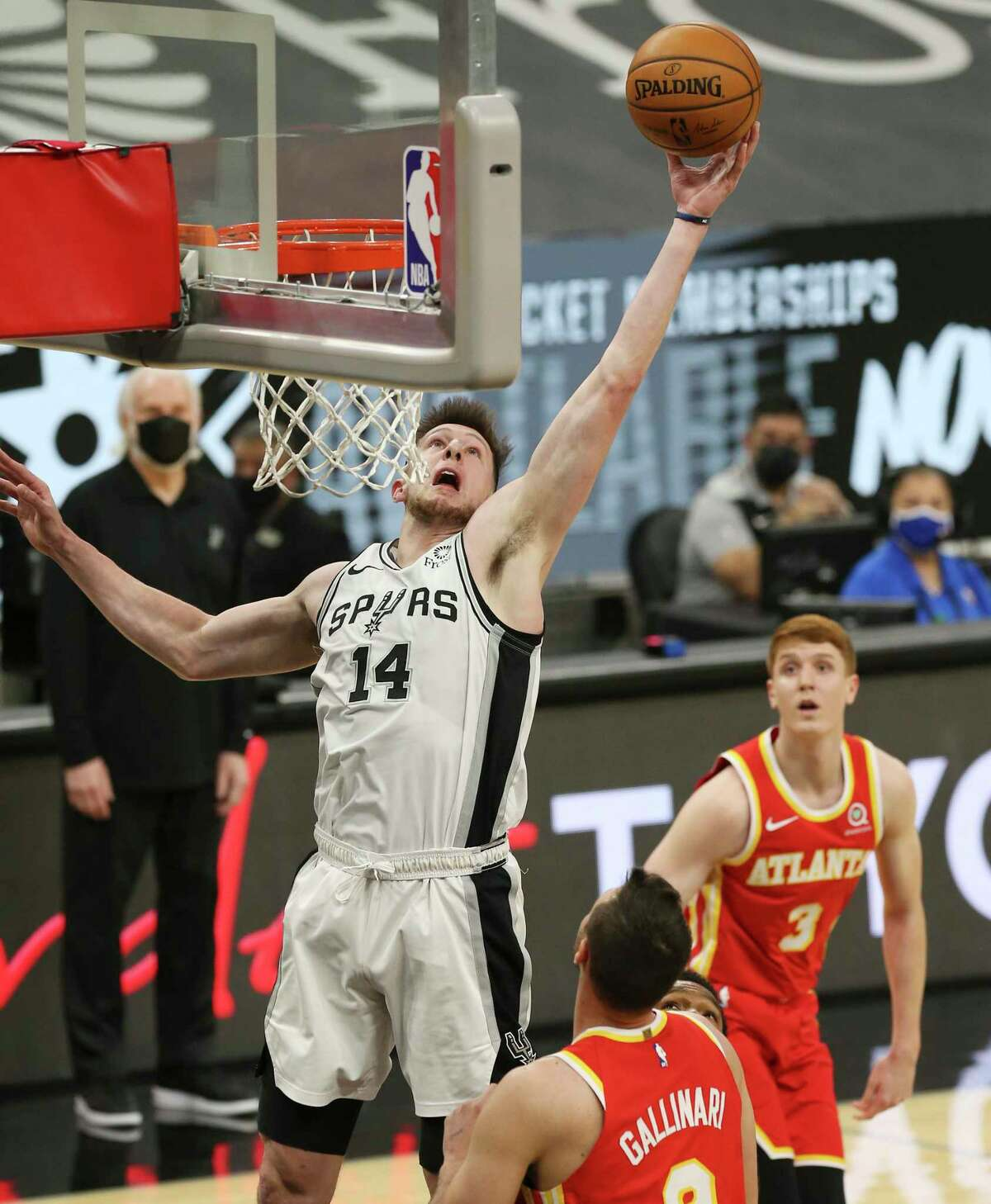 Spurs' Drew Eubanks (14) attempts to put back a shot against Atlanta Hawks' Danilo Gallinari (08) during their game at the AT&T Center on Thursday, Apr. 1, 2021.
