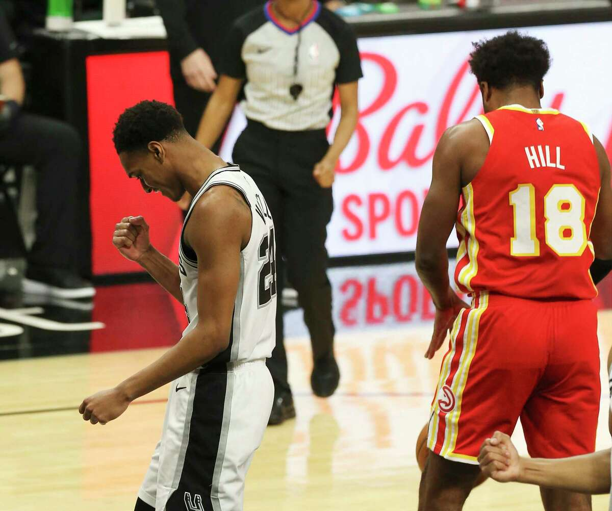 Spurs' Devin Vassell (24) reacts after a score on a foul against Atlanta Hawks' Solomon Hill (18) during their game at the AT&T Center on Thursday, Apr. 1, 2021.