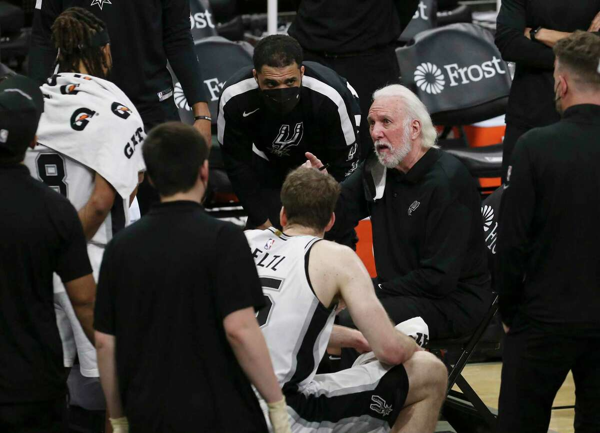 Spurs head coach Gregg Popovich talks to the team during a timeout in the game against the Atlanta Hawks at the AT&T Center on Thursday, Apr. 1, 2021. Hawks defeated the Spurs in double overtime, 134-129.