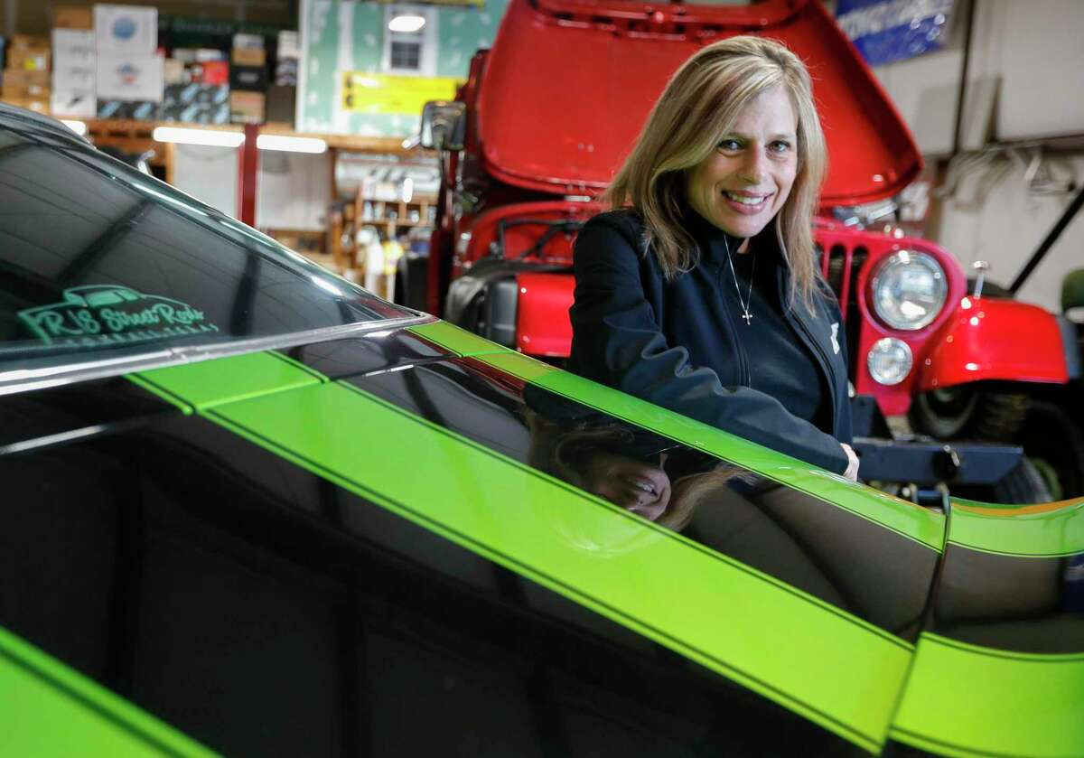 Dana Pritchard, a founding members of The Woodlands Car Club, poses for a portrait at her shop The Woodlands Performance and Suspension, Thursday, April 1, 2021, in Spring. The club is celebrating its 20th anniversary this year.