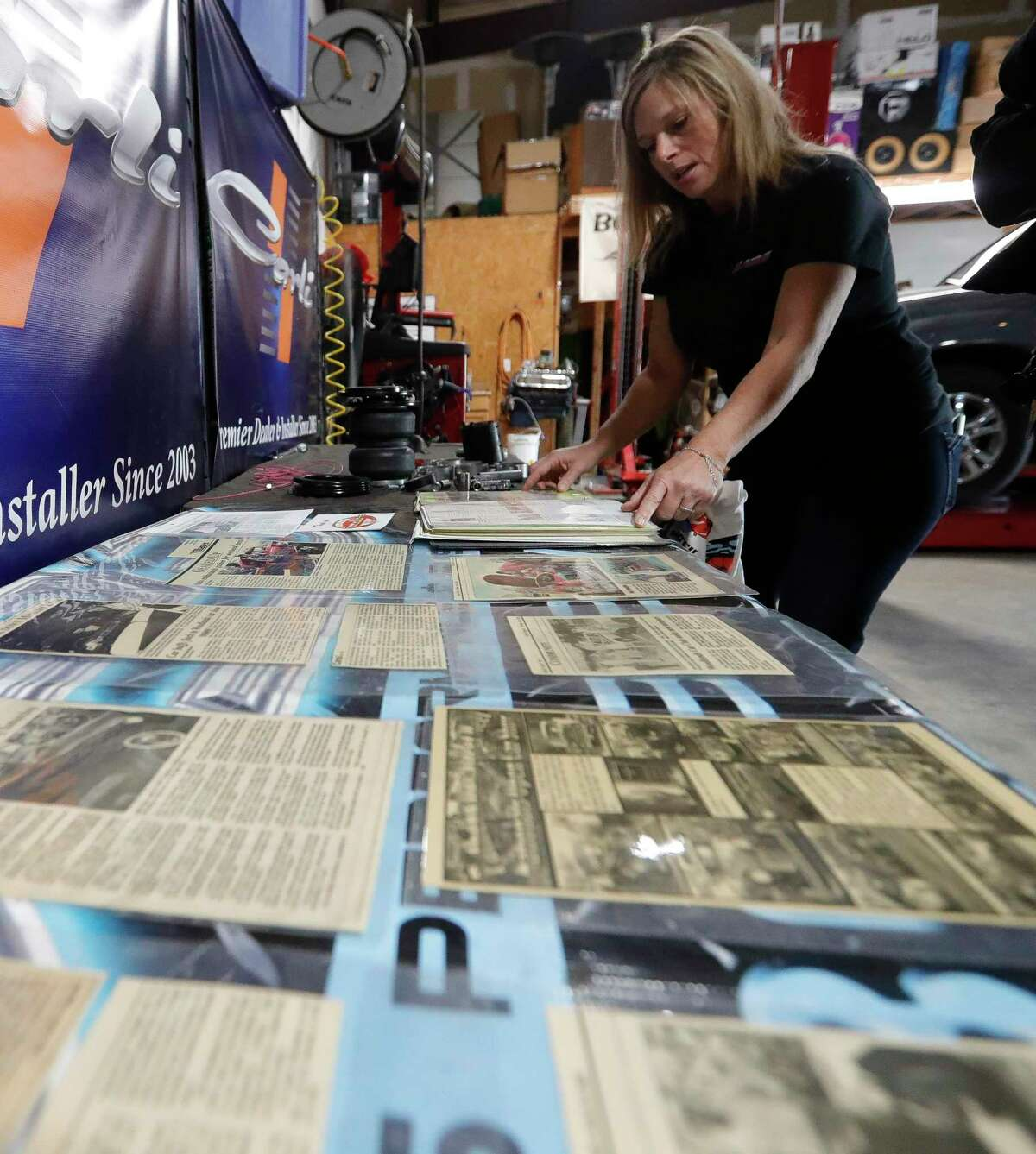 Dana Pritchard goes through articles featuring The Woodlands Car Club at her shop The Woodlands Performance and Suspension, Thursday, April 1, 2021, in Spring. Pritchard is one of the founding members of the club, which is celebrating its 20th anniversary this year.