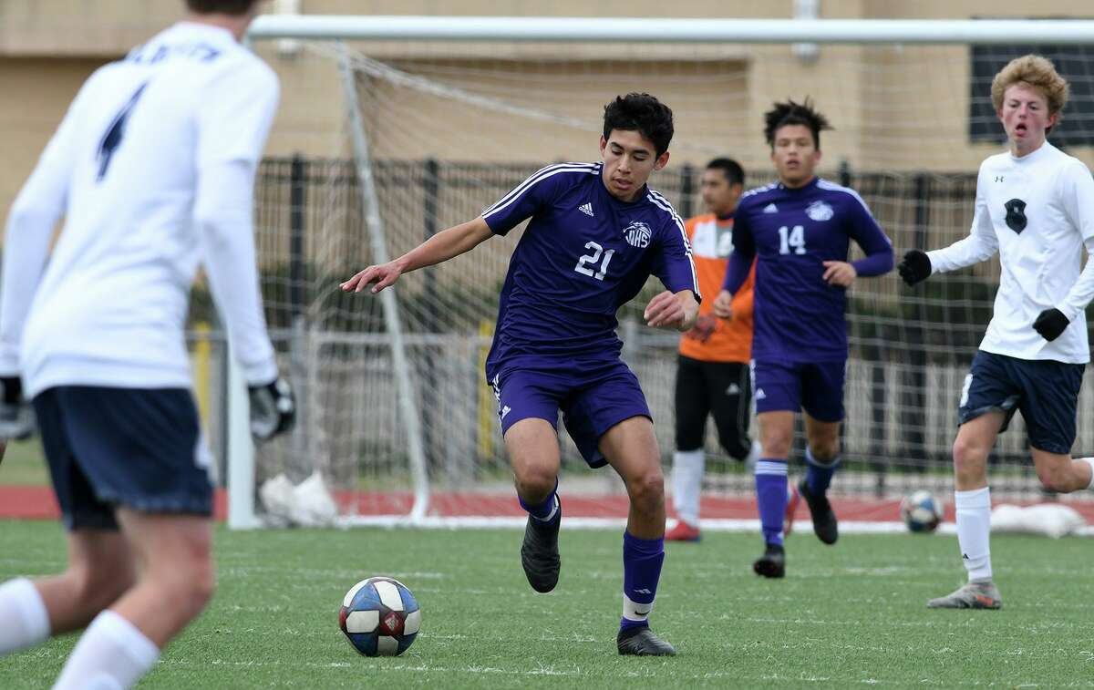 Jersey Village sophomore Maximiliano Bejarano (21) works the ball upfield against Tomball Memorial during their matchup in the Klein Showcase Varsity Soccer Tournament at Klein Memorial Stadium on Jan. 11, 2020.