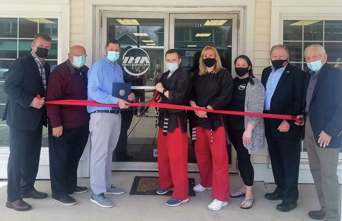 Impact Martial Arts in Cromwell held a grand opening March 25. From left are Middlesex County Chamber of Commerce Cromwell Division Chairman Rodney Bitgood, Town Manager Tony Salvatore, Mayor Enzo Faienza, owner Orest Markiv, studio operator Amy Feldman, program director Rachele Bond, Chamber past chairman Jay Polke and Chamber President Larry McHugh.
