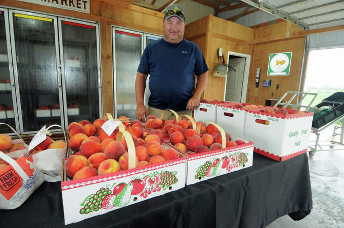 Jacobs Orchard and Farms' owner Roy Jacobs is shown with Early Star peaches in June 2020. Warm temperatures in March prompted an earlier than normal stone fruit blooms. Unfortunately, an early bloom also increases the risk of significant freeze damage to crops such as peaches and cherries.