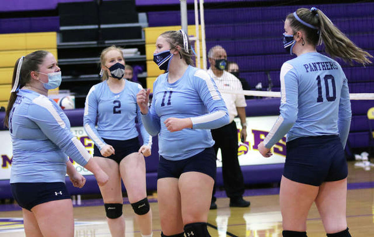 Jersey's (from left) Abby Droege, Sally Hudson, Boston Talley and Caroline Gibson celebrate a point during a MVC match earlier this season at Bethalto. On Thursday night, the Panthers celebrated their first-ever MVC victory over Triad in a two-set sweep in Troy.