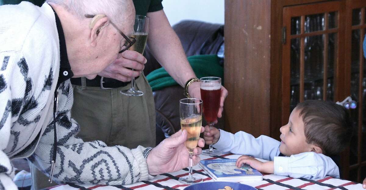 Grandpa Hap toasting with with Aidan Fisher-Paulson when he was a toddler.