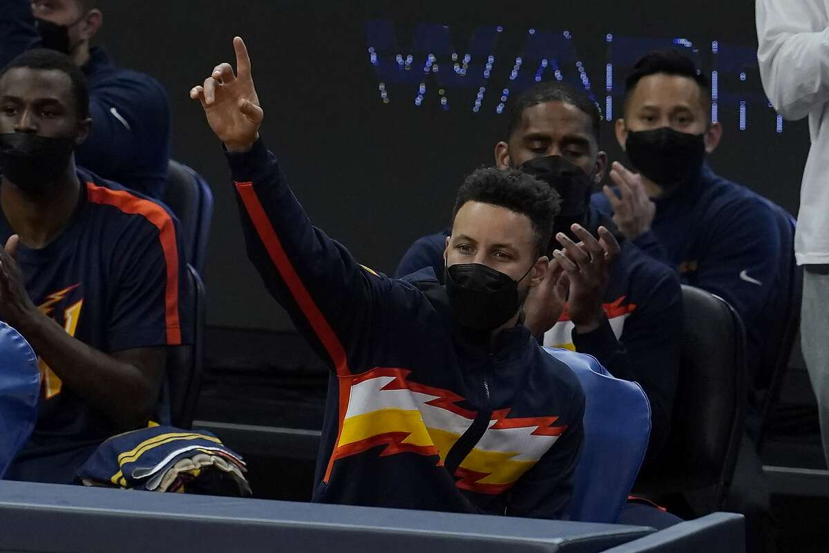 Golden State Warriors guard Stephen Curry gestures against the Philadelphia 76ers during an NBA basketball game in San Francisco, Tuesday, March 23, 2021. (AP Photo/Jeff Chiu)