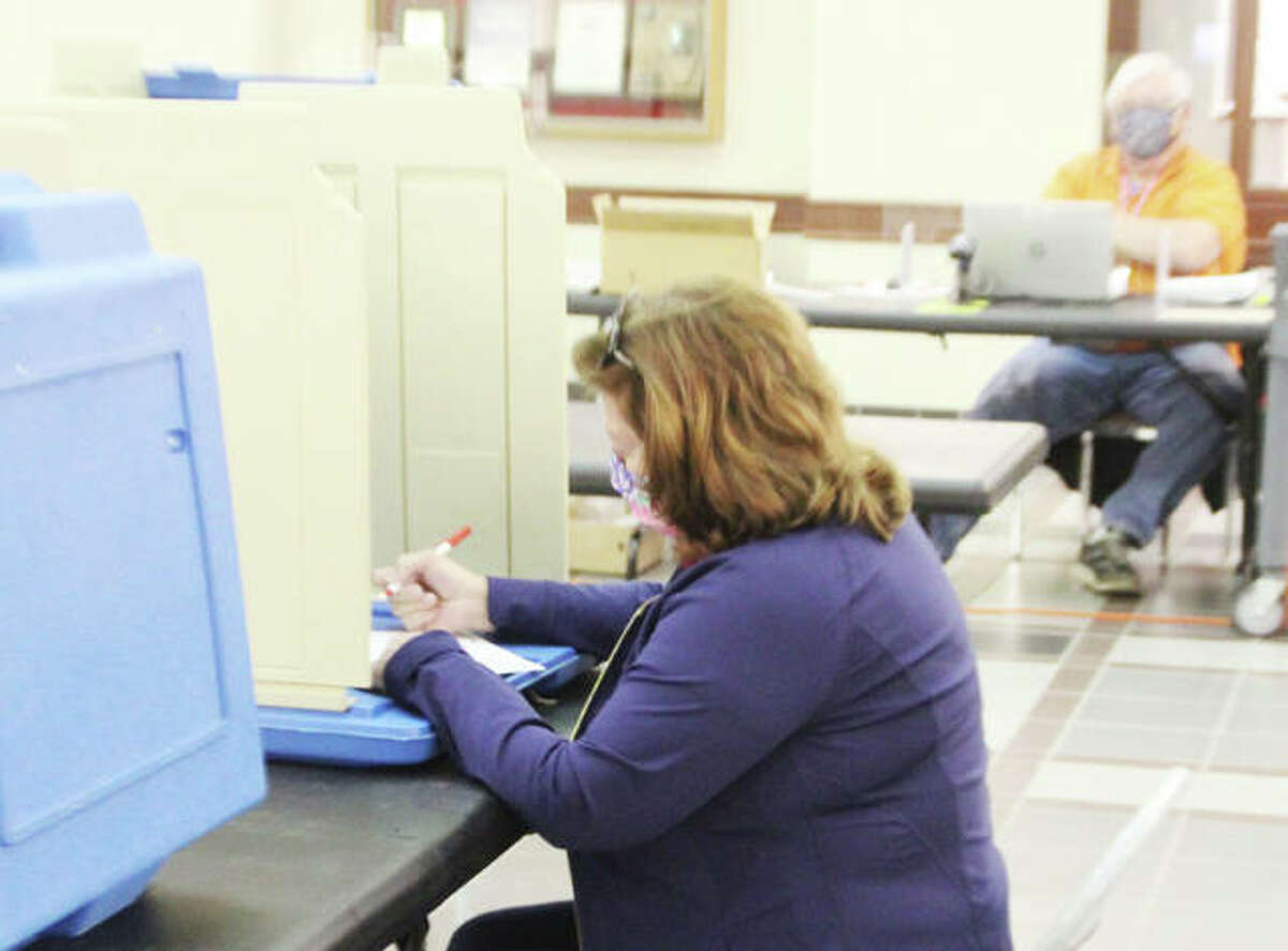 Debby Niebur, of Edwardsville, casts her ballot during early voting at the Madison County Administration Building Thursday morning. Early voting continues Saturday and Monday at limited locations; then polls are open 6 a.m. to 7 p.m. Tuesday, April 6.