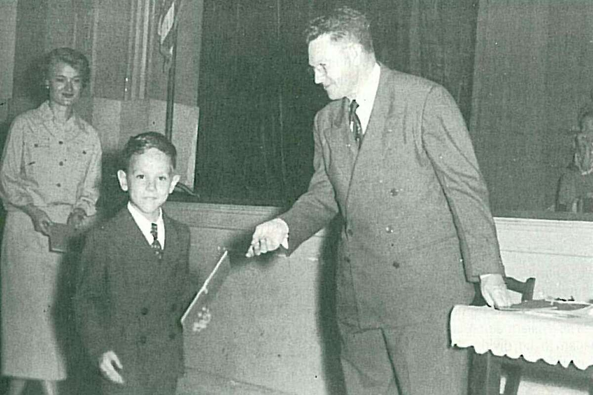 B.B. Rice, right, hands a diploma to a kindergarten student at Sam Houston Elementary. Rice was the principal there for many years.