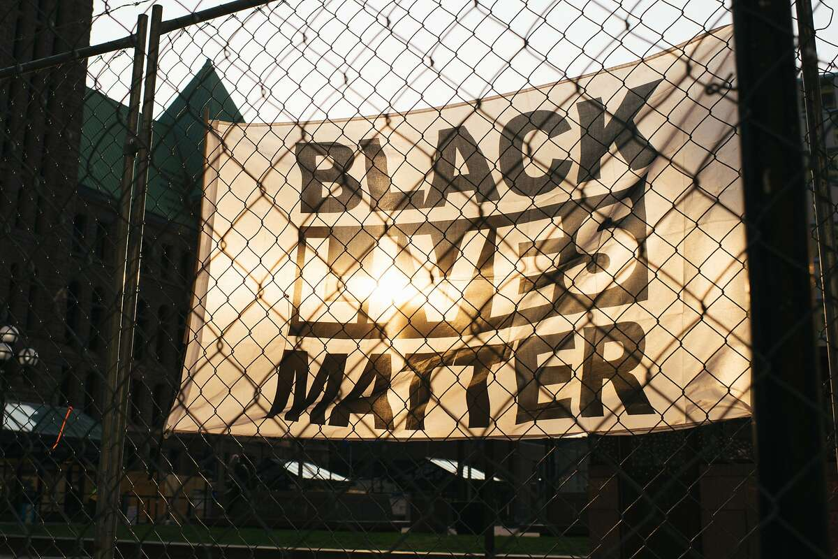 A Black Lives Matter banner was displayed on fencing around the Hennepin County Government Center in Minneapolis last week, when the prosecution began presenting the case against former Minneapolis police officer Derek Chauvin, who is charged with multiple counts of murder in the death of George Floyd.