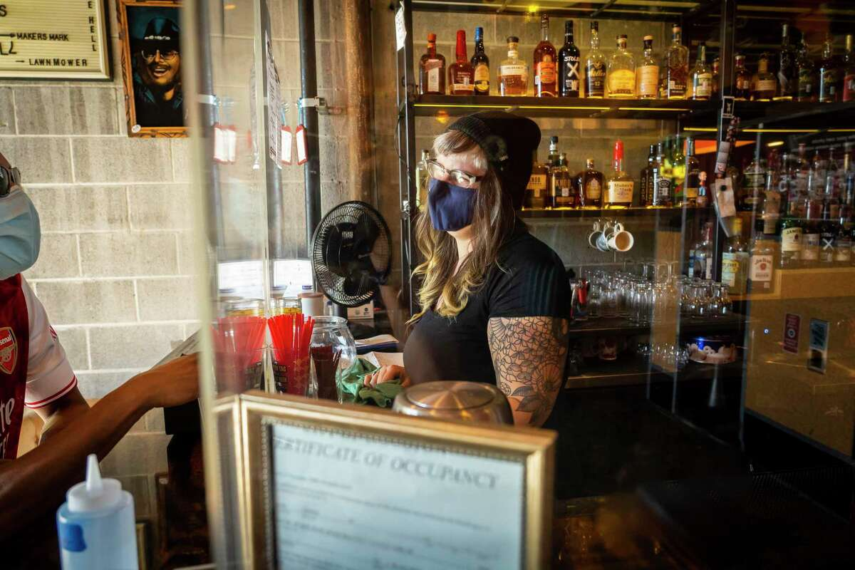 Lindsay Rae Burleson, owner of Two Headed Dog in Midtown, said some resourceful members of Houston's restaurant community crowdsourced vaccination information, and so her bar's staff was fully vaccinated. After that, she and her team decided to remove the Plexiglas shield between bartenders and customers.