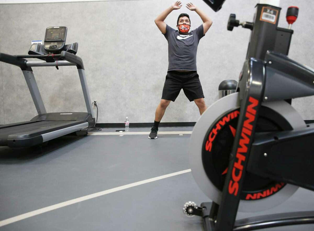 Joel Preses of Houston warms up in a smaller gym inside 24 Hour Fitness in the Heights neighborhood of Houston on Tuesday, March 9, 2021. The CDC has since said it was safe to gather indoors with other vaccinated people. The question is whether restaurants and retailers now advertise, signs and all, that their teams are fully vaccinated so vaccinated customers can enter without need for a mask.