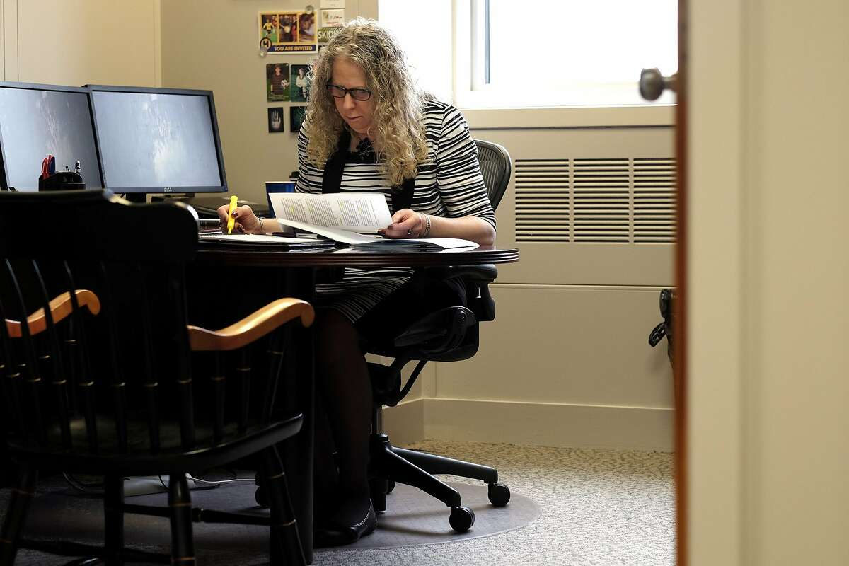 HARRISBURG, PA,- MAY 17: Rachel Levine, MD, physician general for the state of Pennsylvania, works at her desk in Harrisburg, PA, on May 17, 2016. Levine is transgender. (Photo by Bonnie Jo Mount/The Washington Post via Getty Images)