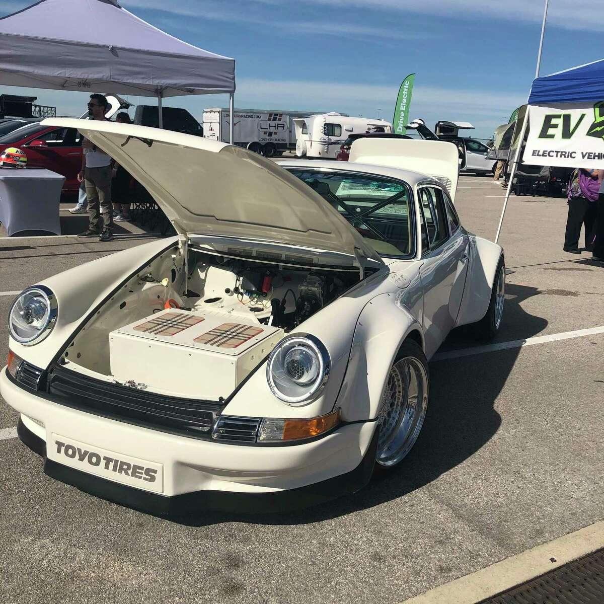 An electric Porsche goes on display in Austin. Some electric cars reportedly can power a single-family home for about a week if its battery is fully charged.