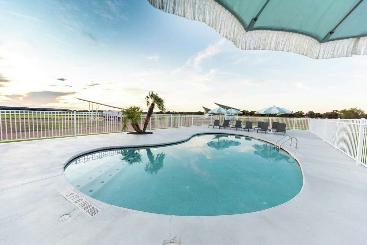 Shared pavilion amenities at Blue Skies include a kidney-shaped pool.