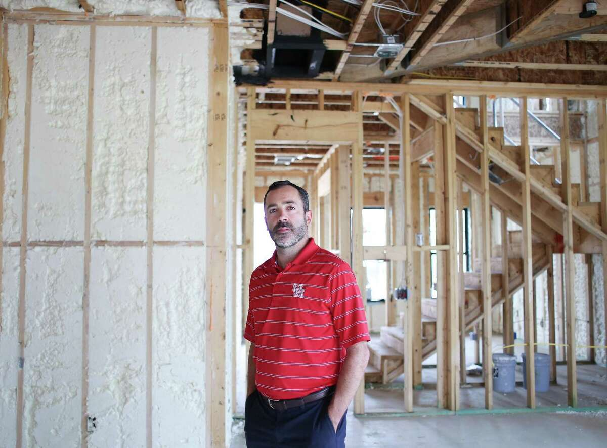 Scott Burrer, general manager at Sullivan Brothers Builders, stands in one of their new homes in Houston on Wednesday, March 31, 2021. According to Burrer, the company can't even get a timeframe from suppliers on when the shortages and high prices will end for some building supplies including installation and flooring.
